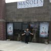 The cages are down and a sign is up-we feel free again at Manoli's Jewelers.